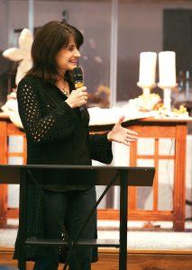 Debi Nixon addresses the training session in preparation for the annual Leadership Institute.